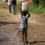 girl carries water